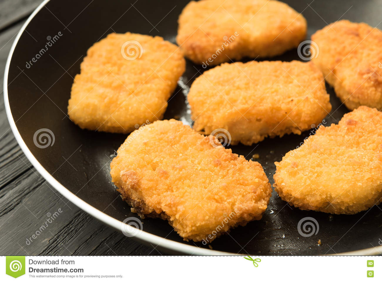 Cooked Chicken Nuggets In Fryingpan