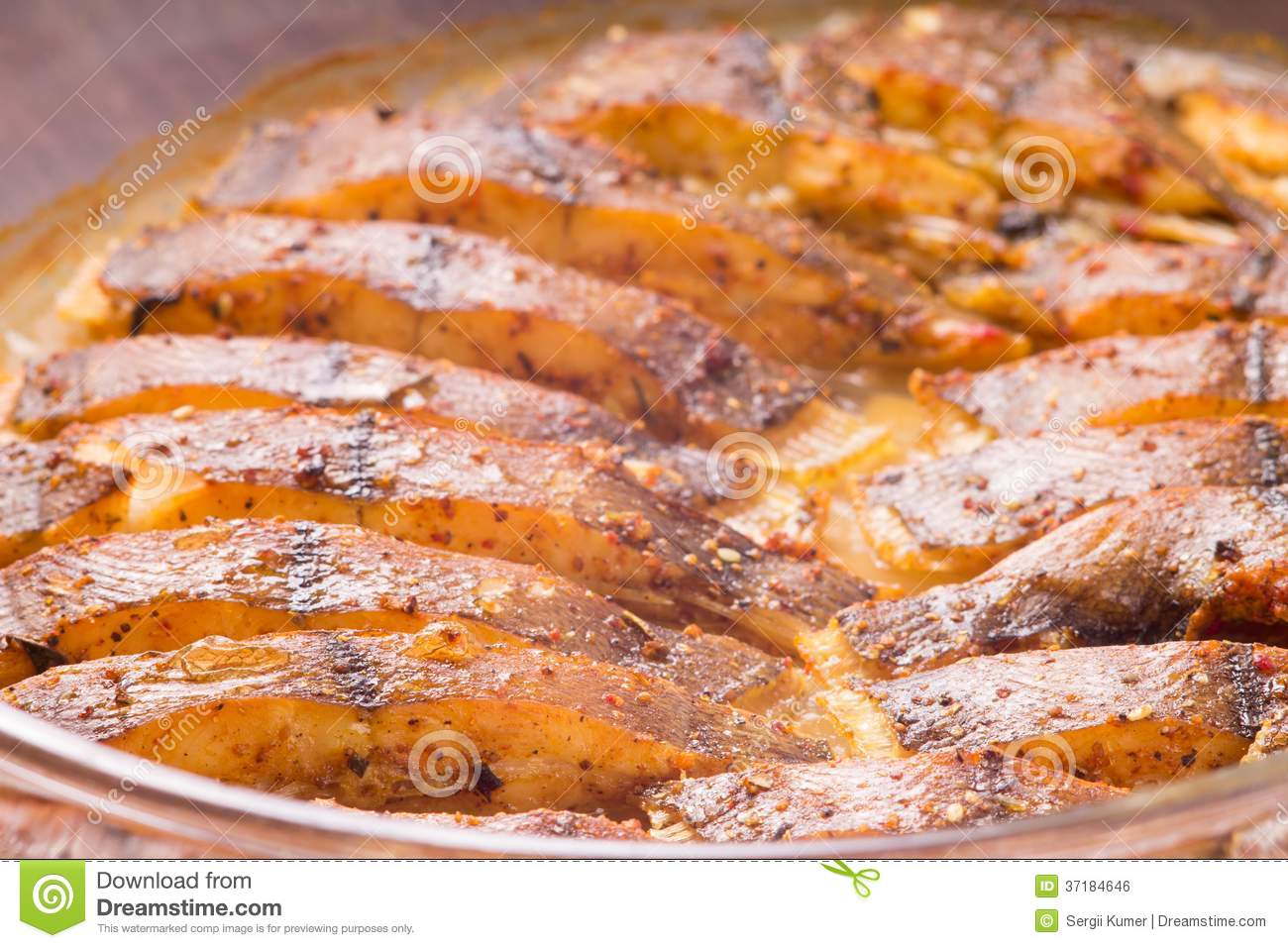 Cooked fish with spices royalty free stock image image for Baked fish seasoning