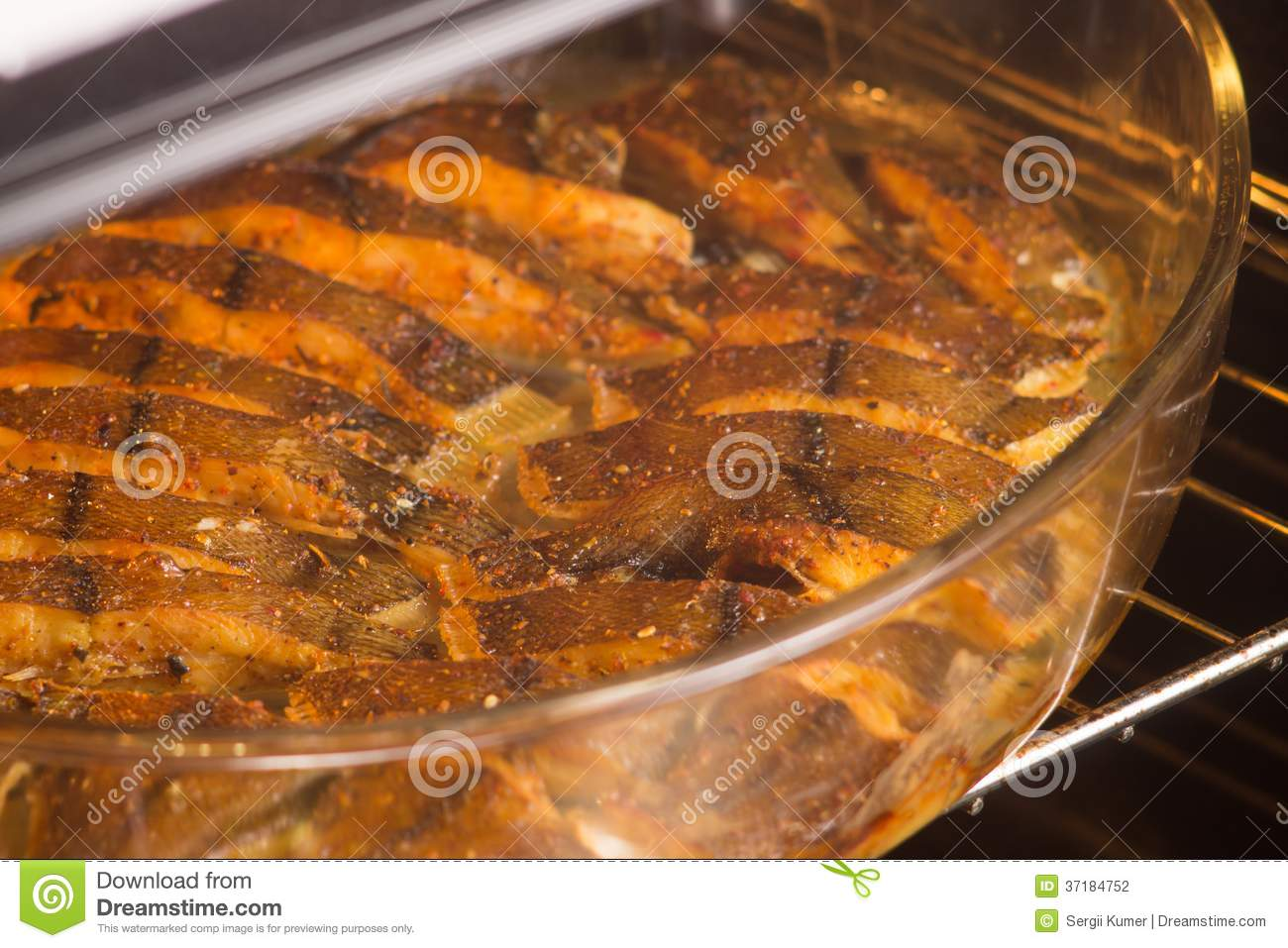 Cooked fish with spices in oven stock photography image for Fish in oven