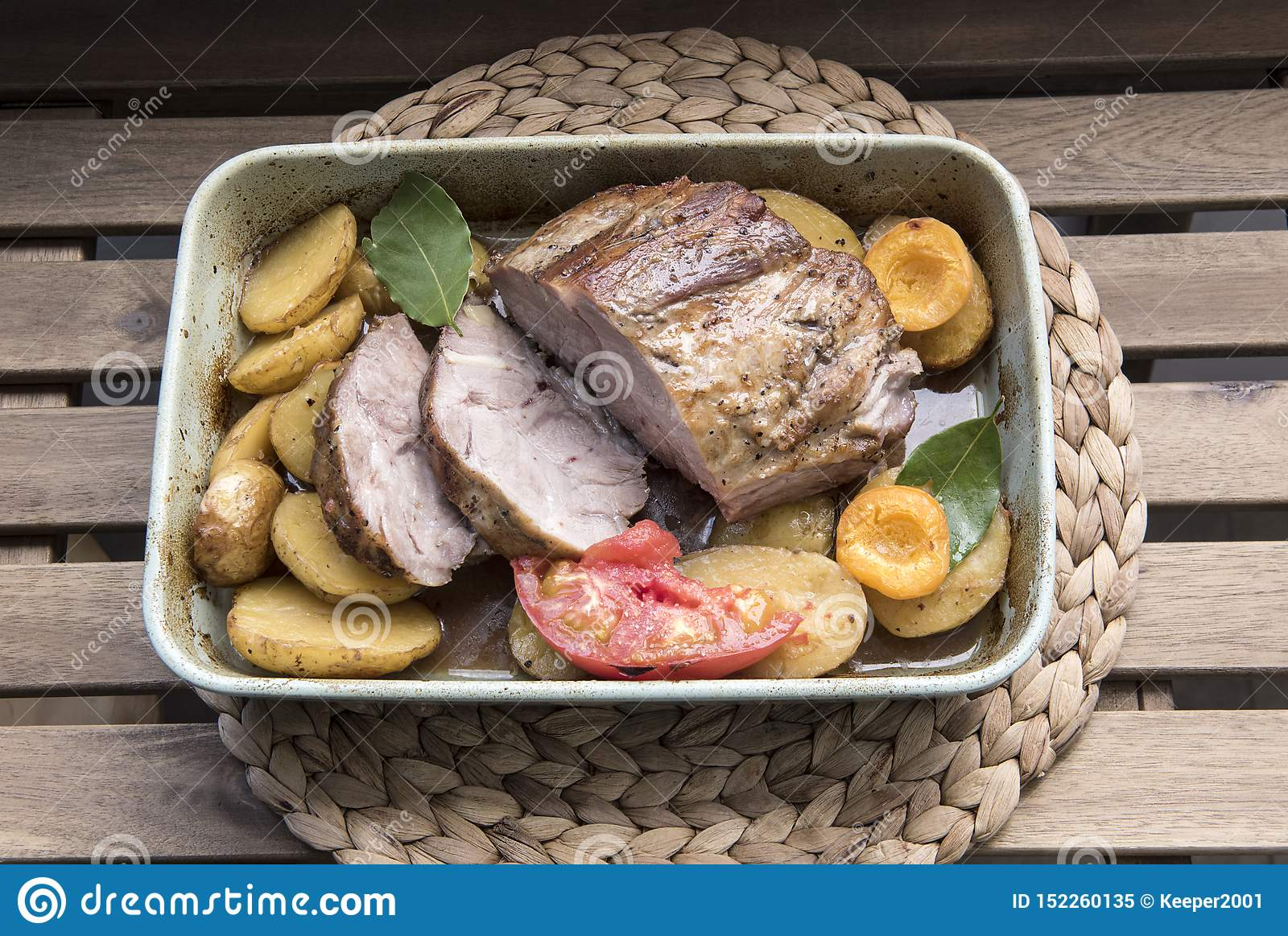 Cooked meat with vegetables and fruits on a platter