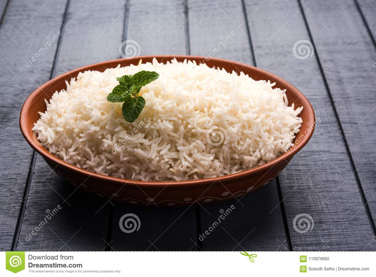 Cooked plain white basmati rice in terracotta bowl, selective focus