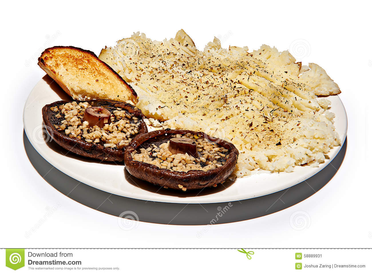 Cooked Portabella With Garlic And Baked Potato Stock Photo - Image ...