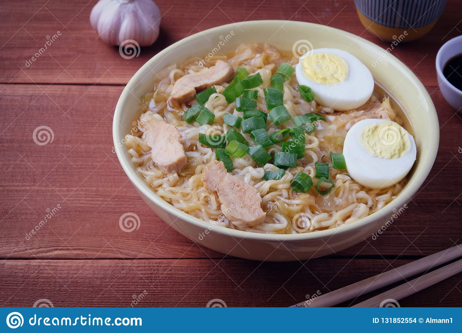 Chinese chicken soup. Cooked in a wok.Wooden background.