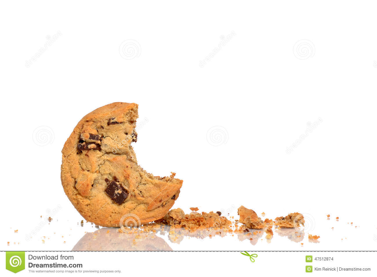 Chocolate chip cookie and crumbs isolated white background.