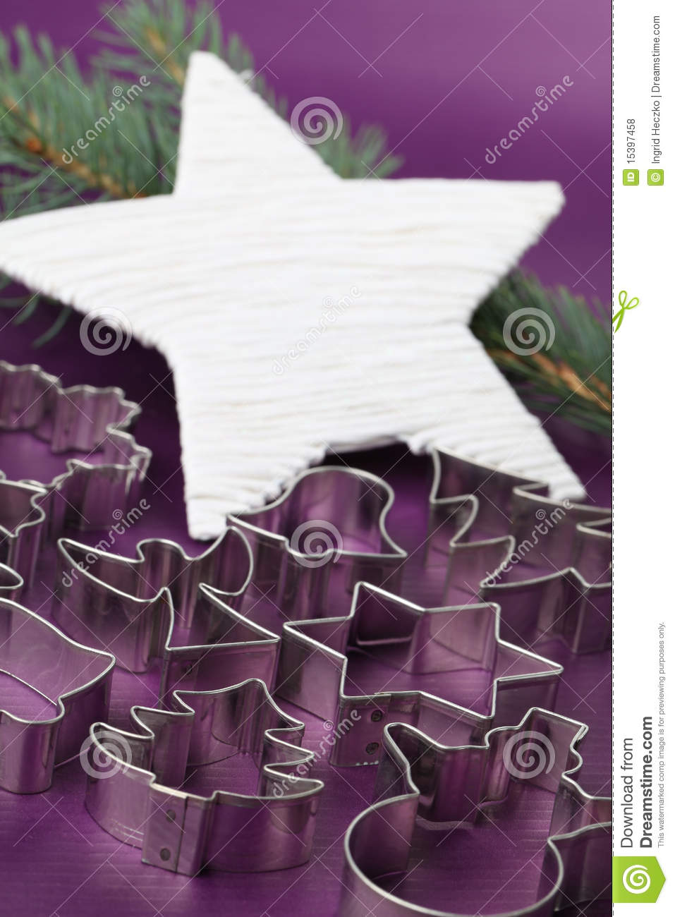 Cookie cutters on Christmas background
