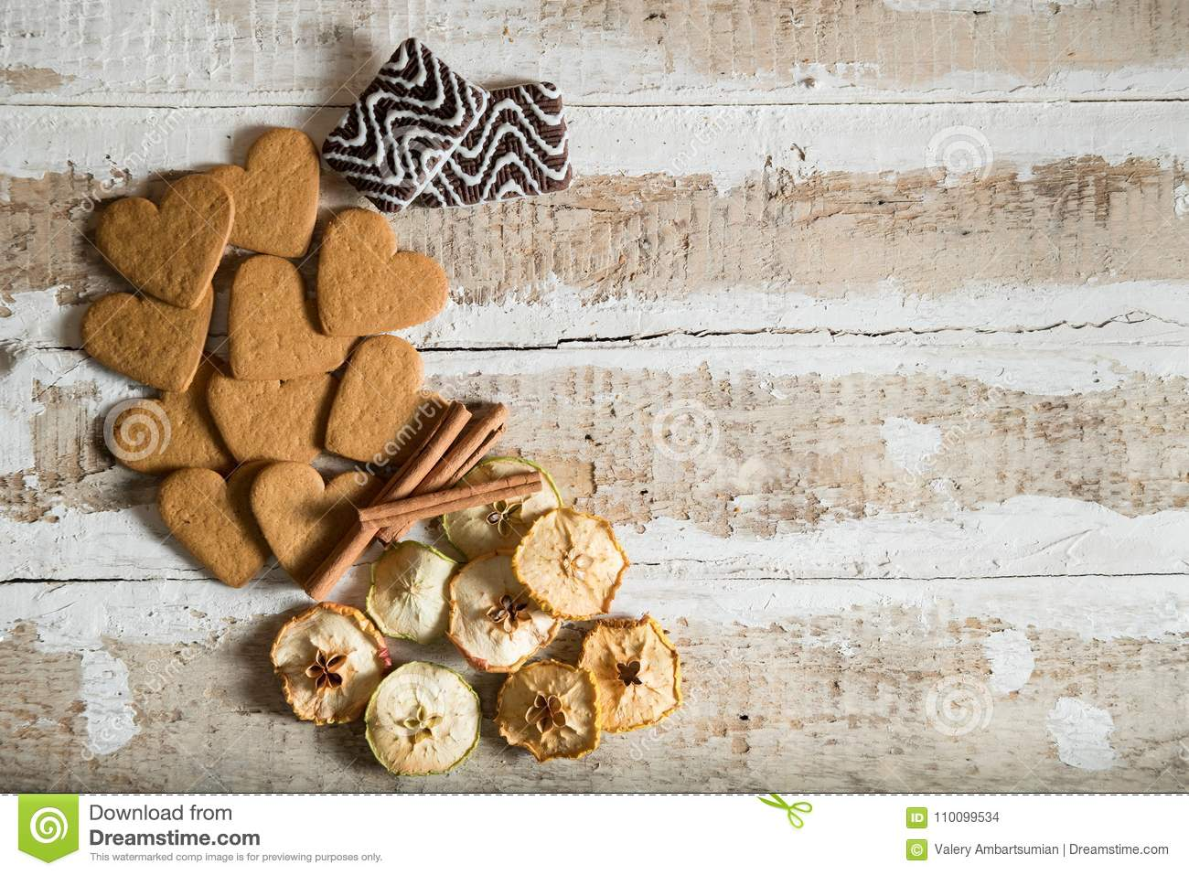 Cookie Hearts And Chocolate With Cinnamon Sticks And Slices Of Dried