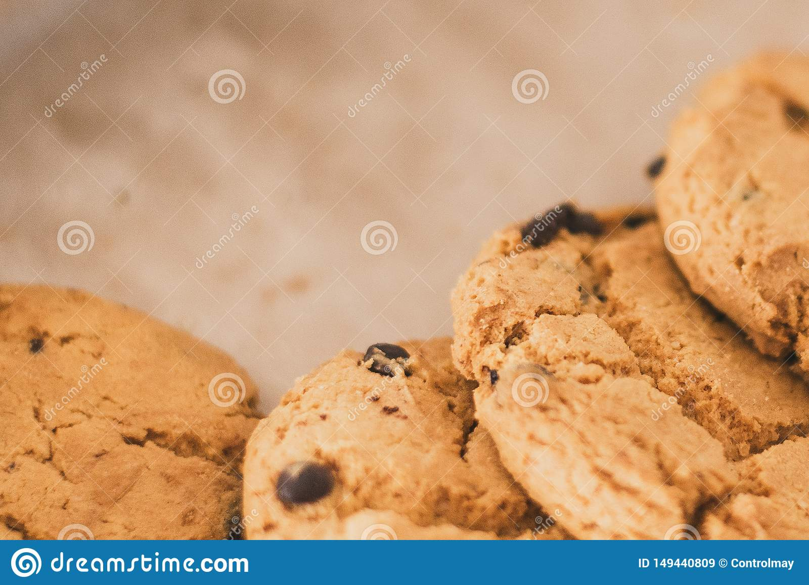 cookies with chocolate in the plate. chocolate chips on cookies close to the lens