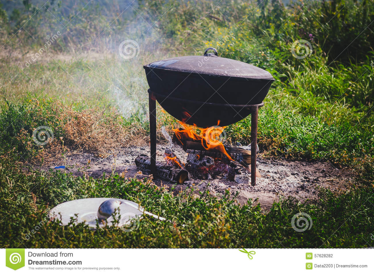 Cooking on fire with pot stock photo image 57628282 for Meal outdoors