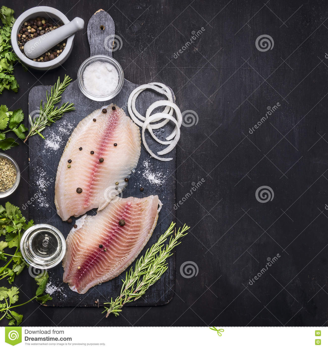Cooking fish with herbs, butter and lemon, and pepper in mortar border place for text