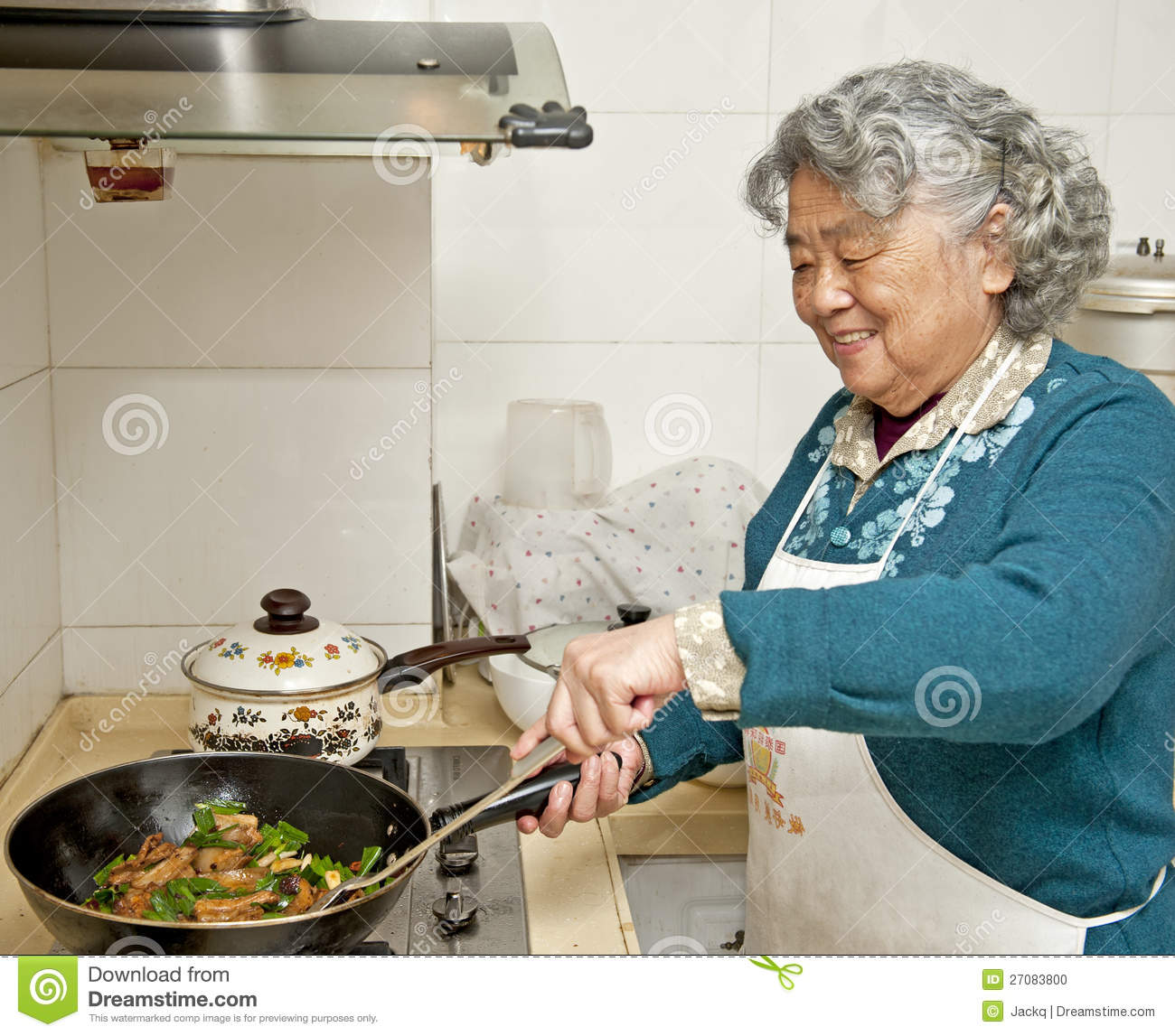 Grandmothers Kitchen: Cooking Grandmother Stock Photo