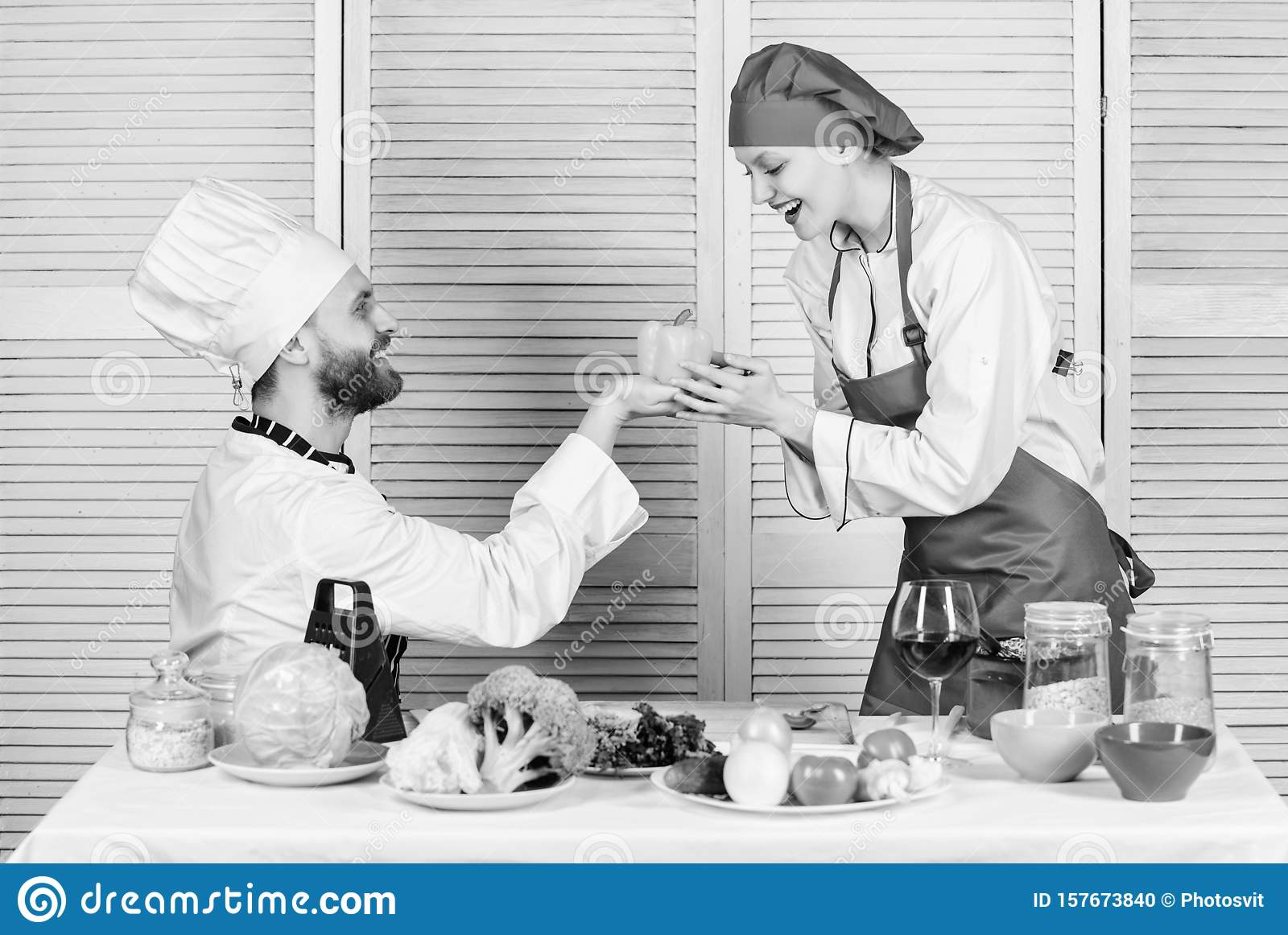 Cooking healthy. vegetarian. cook uniform. happy couple in love with healthy food. man and woman chef in restaurant