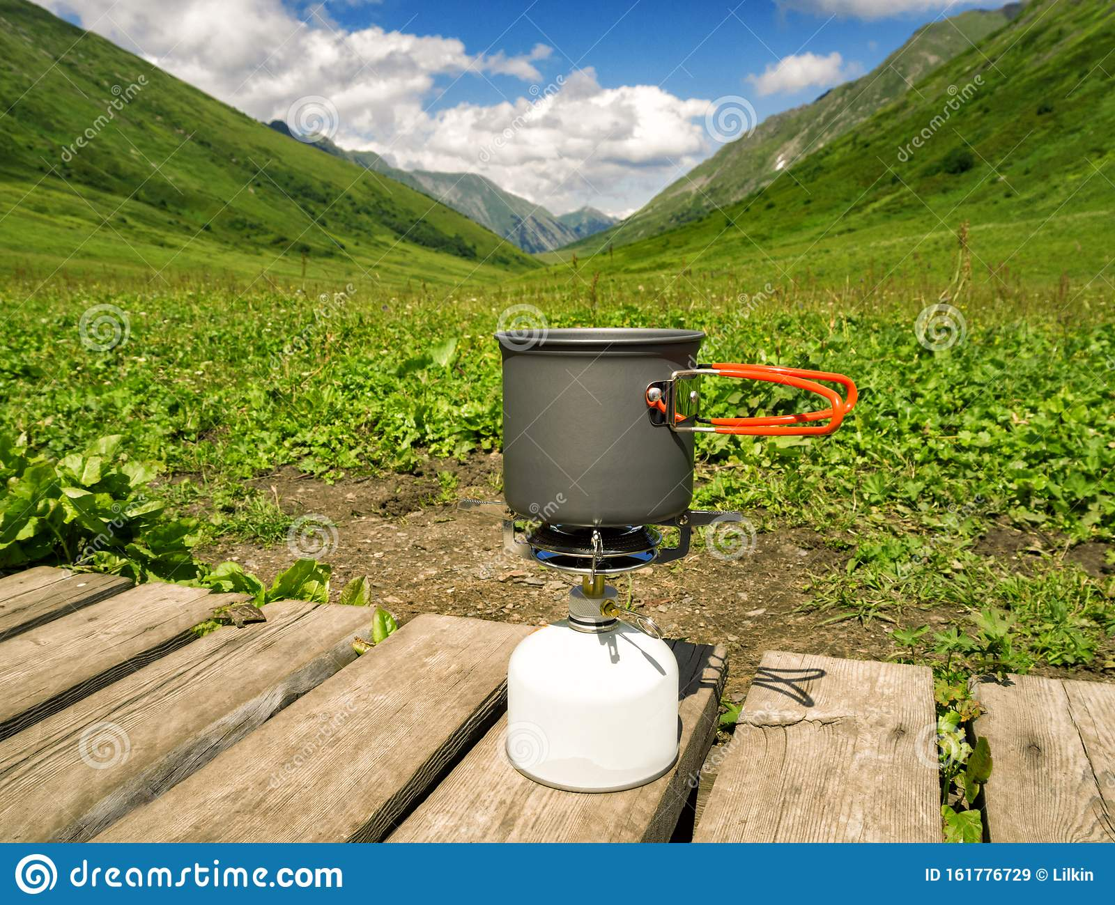 Cooking Pot On Camping Gas Stove At Mountains Background ...