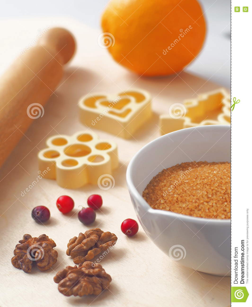 Cooking process. Components for preparing Christmas cookies or cake with some utensils on a table.
