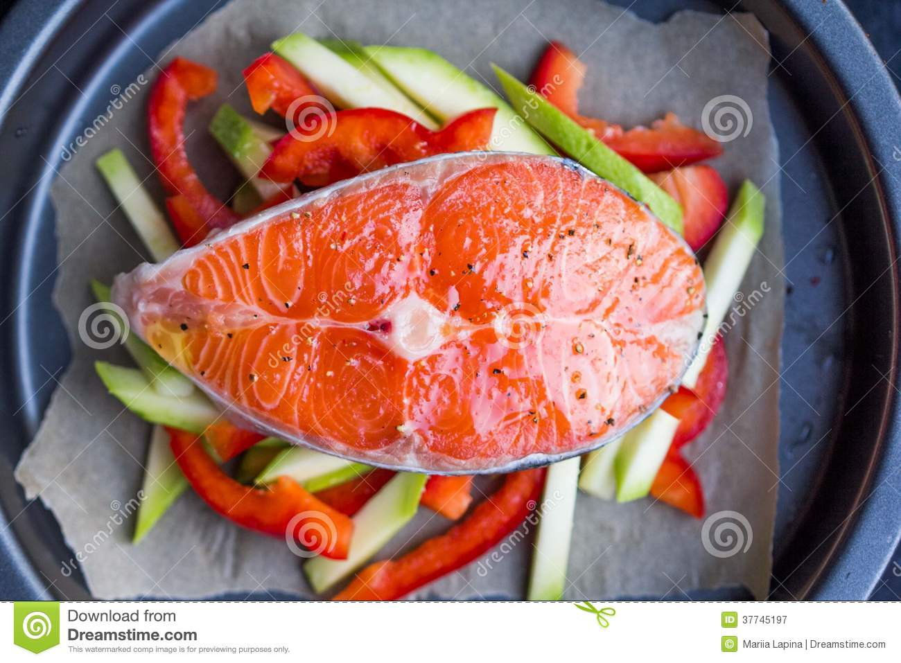 Cooking raw steak of red fish salmon on vegetables for How to cook red fish
