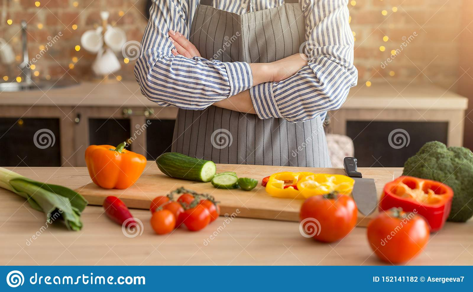 Cooking salad with vegetables. Young woman hands