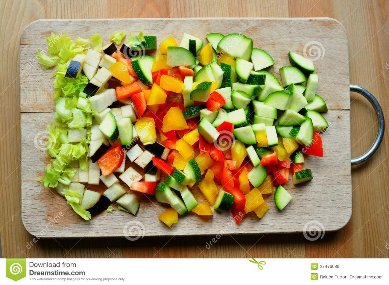 Home cooking from scratch concept with vegetables on a wooden board