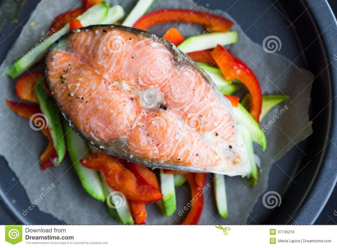 Cooking steak of red fish salmon on vegetables zucchini for How to cook red fish