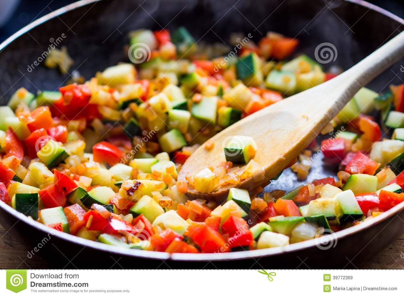 Cooking stew ratatouille from vegetables in frying pan