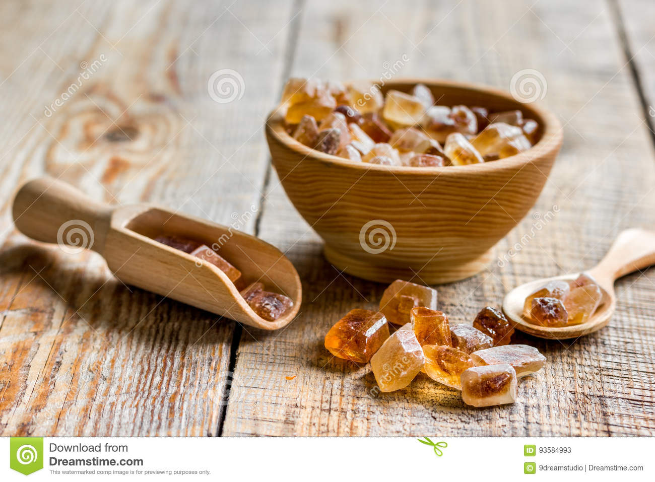 cooking sweets set with different sugar lumps on rustic table background close up
