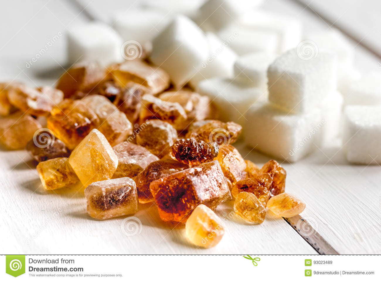 Cooking sweets set with different sugar lumps on white table background close up