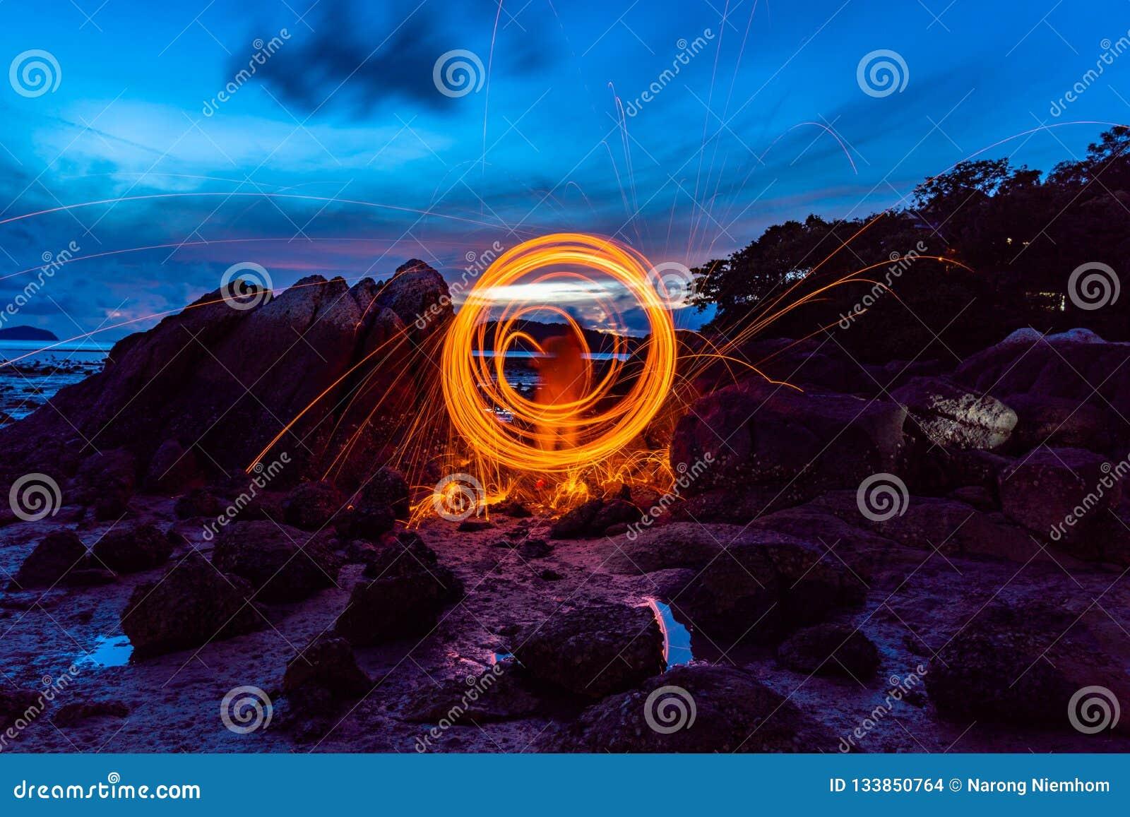 steel wool fire work on the rock