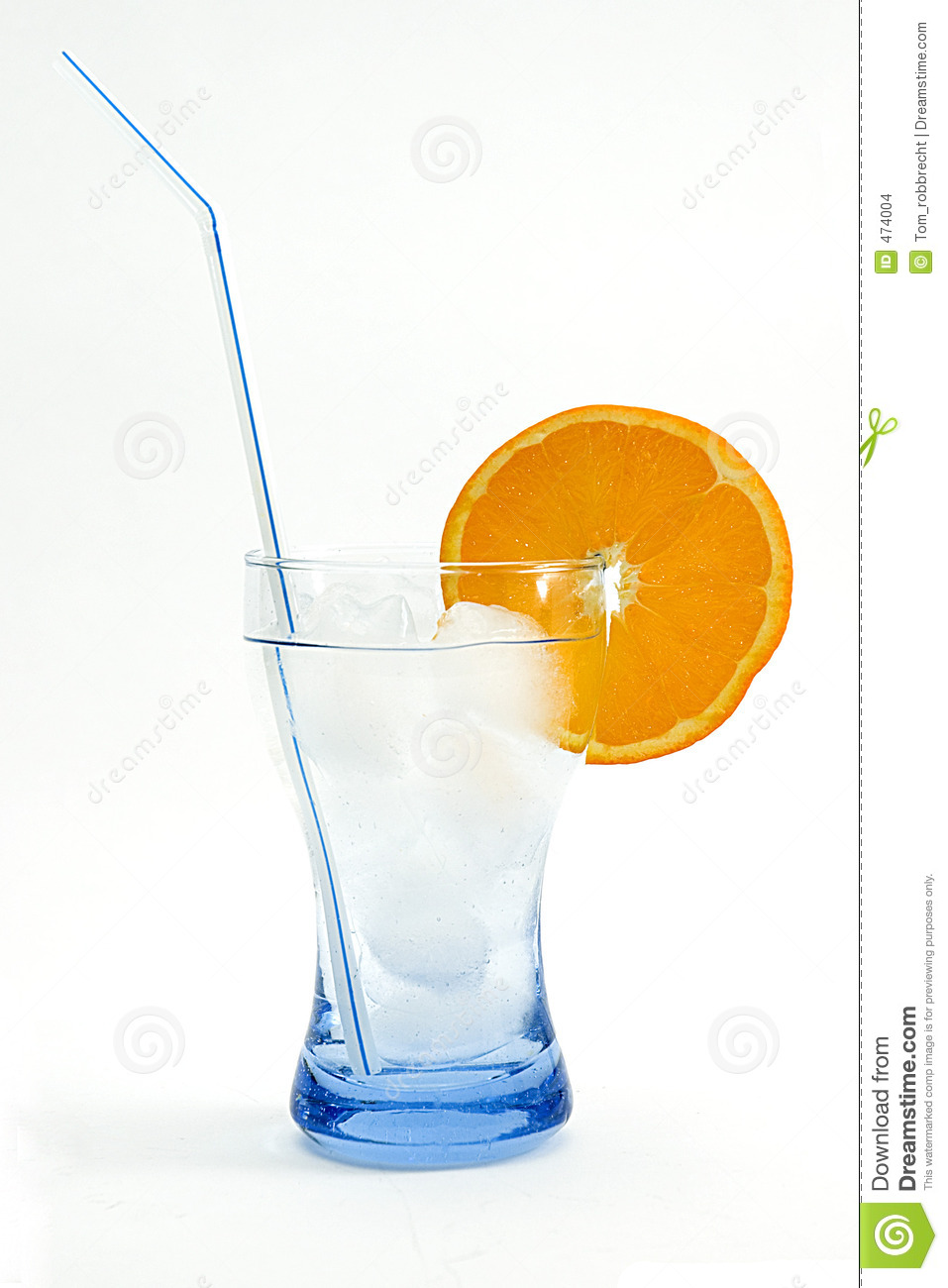 Cool drink in blue glass with ice cubes and orange white background.