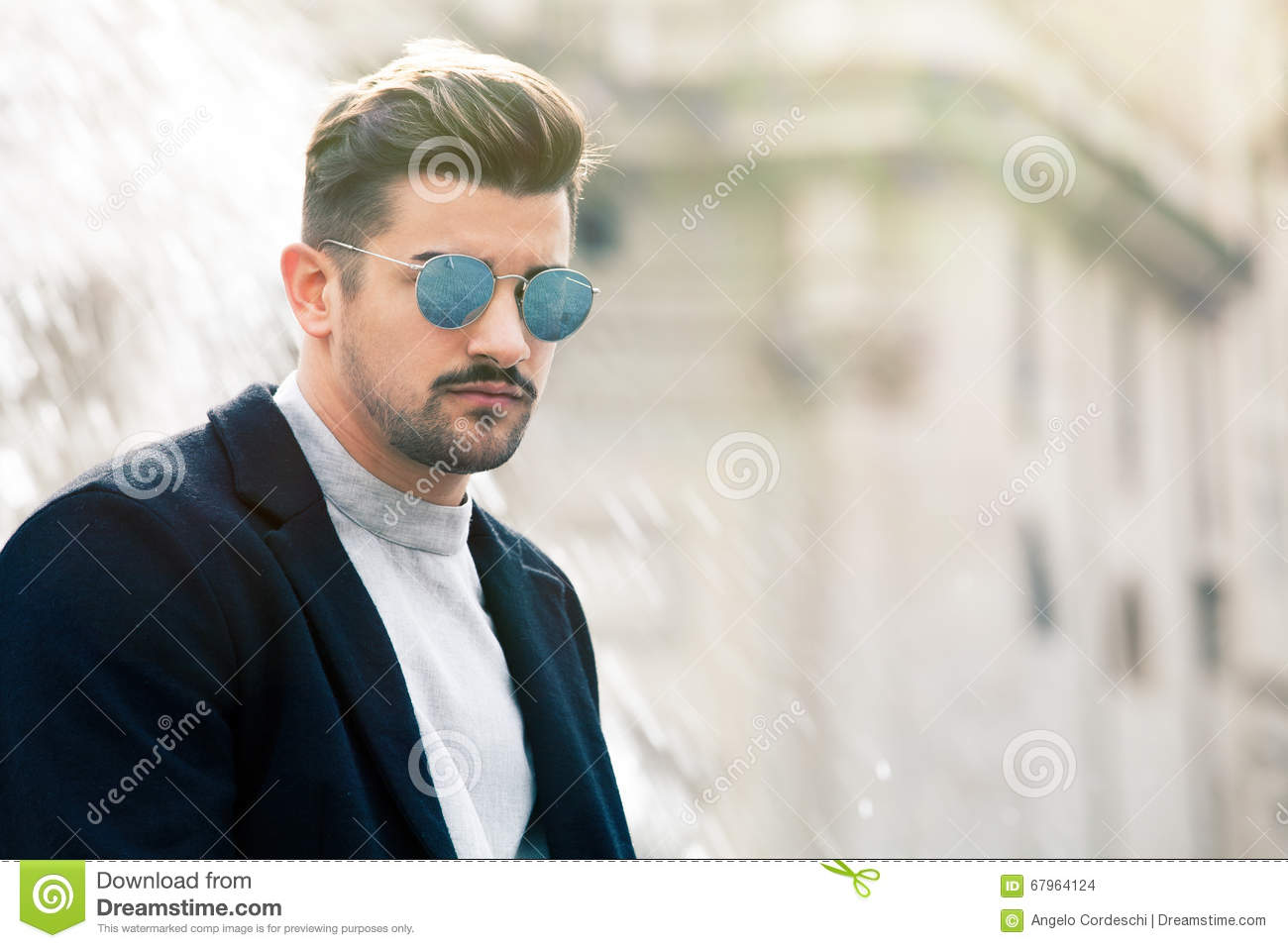 8f32e1aae3e8 A charming young stylish man with sunglasses. Confident attitude with  setting in the historic city of Rome
