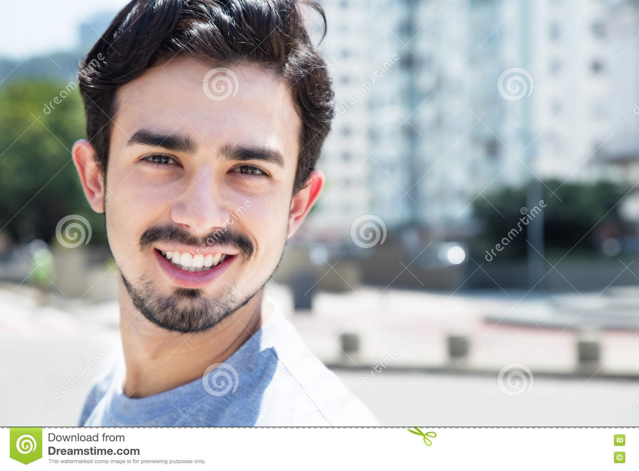 Cool Hispanic Guy In A Grey Shirt In City Stock Image