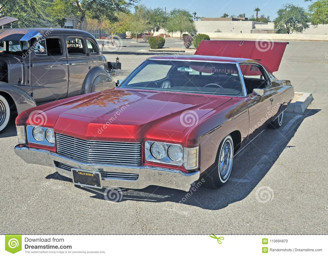 Cool red caddy low rider stock photo image of automotive