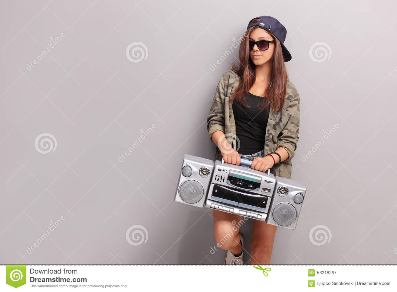 Cool Teenage Girl In Hip Hop Outfit Holding A Radio Stock
