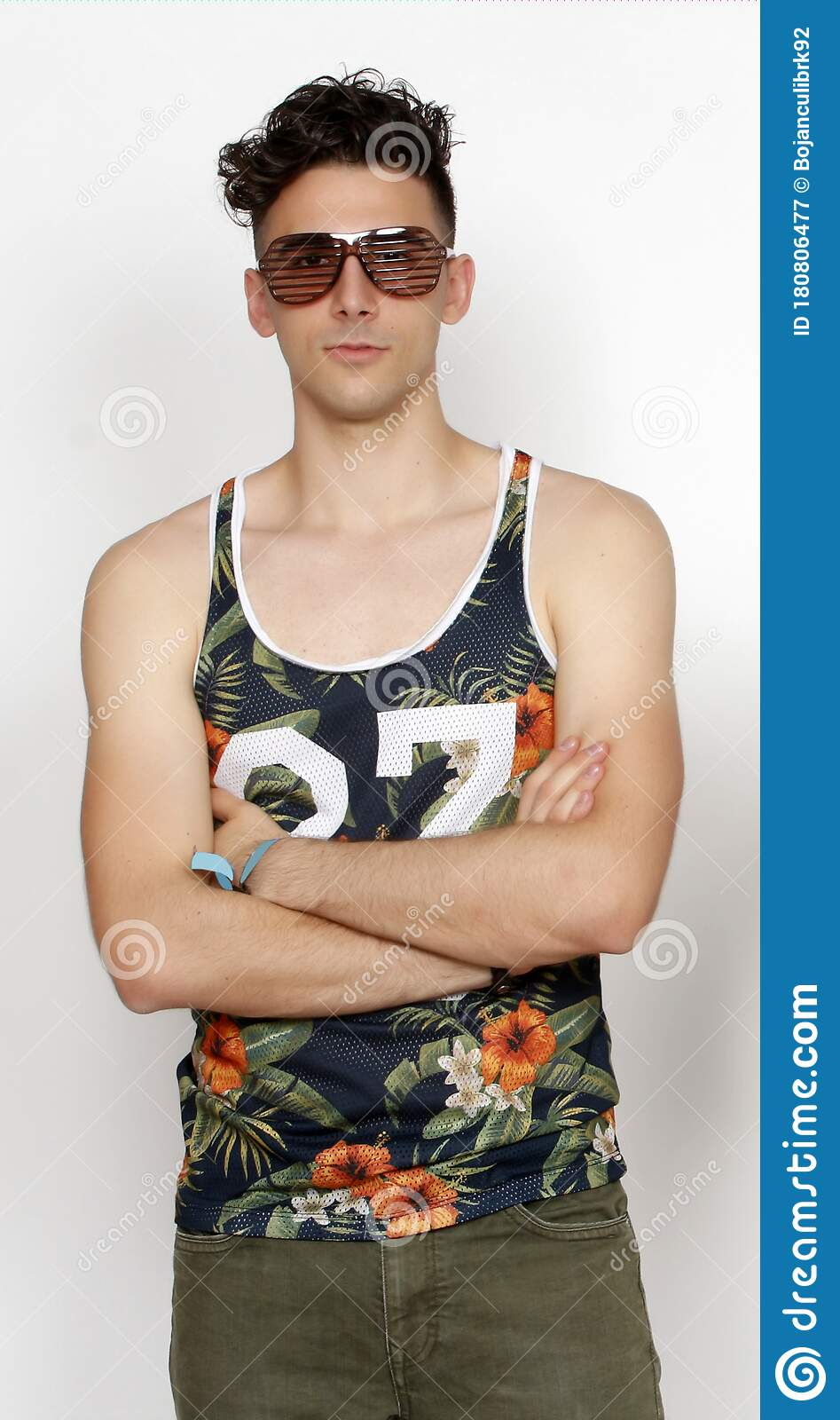Cool Young Hipster Guy With Short Curly Hair And Shutter Shade Glasses Is Posing In Studio On Isolated Background Style Fashion Stock Image Image Of Entertainment Cool 180806477