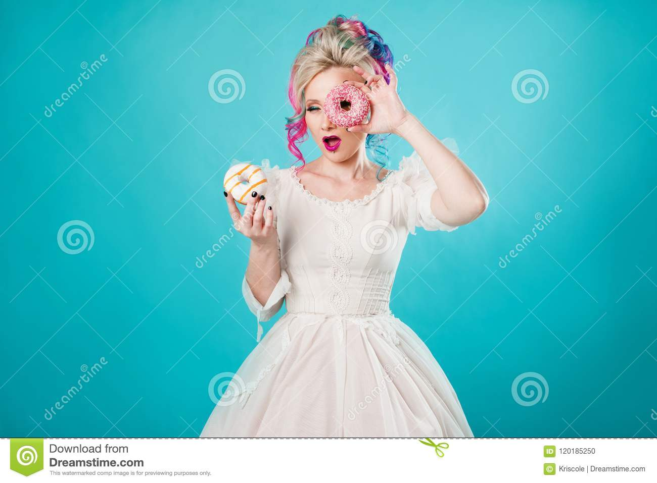 Cool Young Woman With Colored Hair Holds Two Sweet Donuts Funny