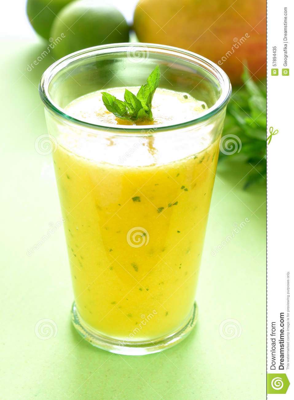 ... table, Yellow Tropical Smoothie made with mango, mint and lime juice