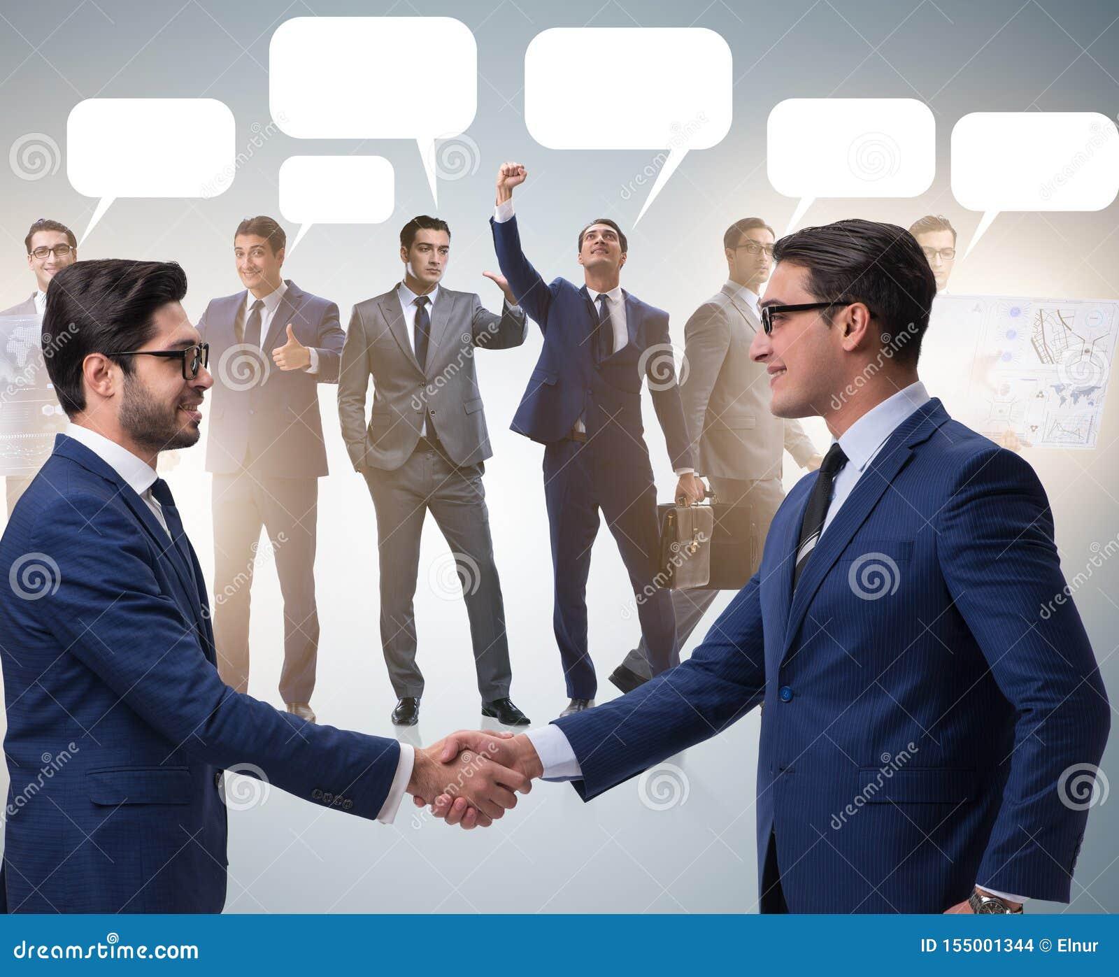 Cooperationa och teamworkbegrepp med handskakningen