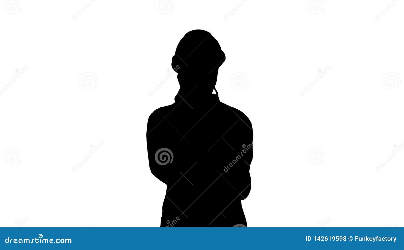 Coordenador da mulher da silhueta que fala no telefone ao andar