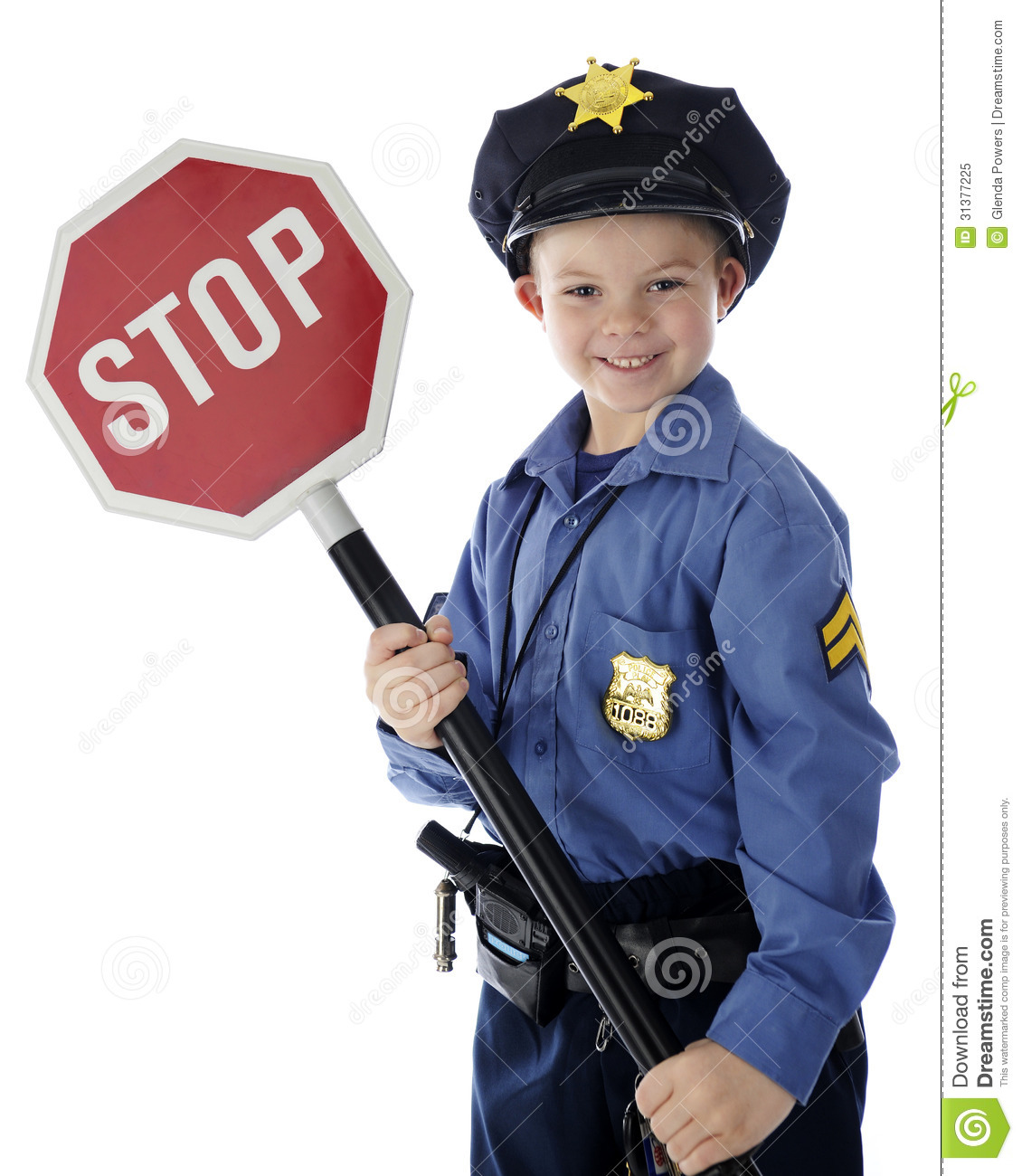 An adorable young policeman happily holding a stop sign. On a white ...