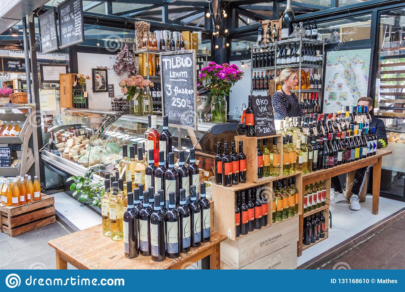 COPENHAGEN, DENMARK - AUGUST 28, 2016: Wine and cheese stall inTorvehallerne indoor food market in the centre of