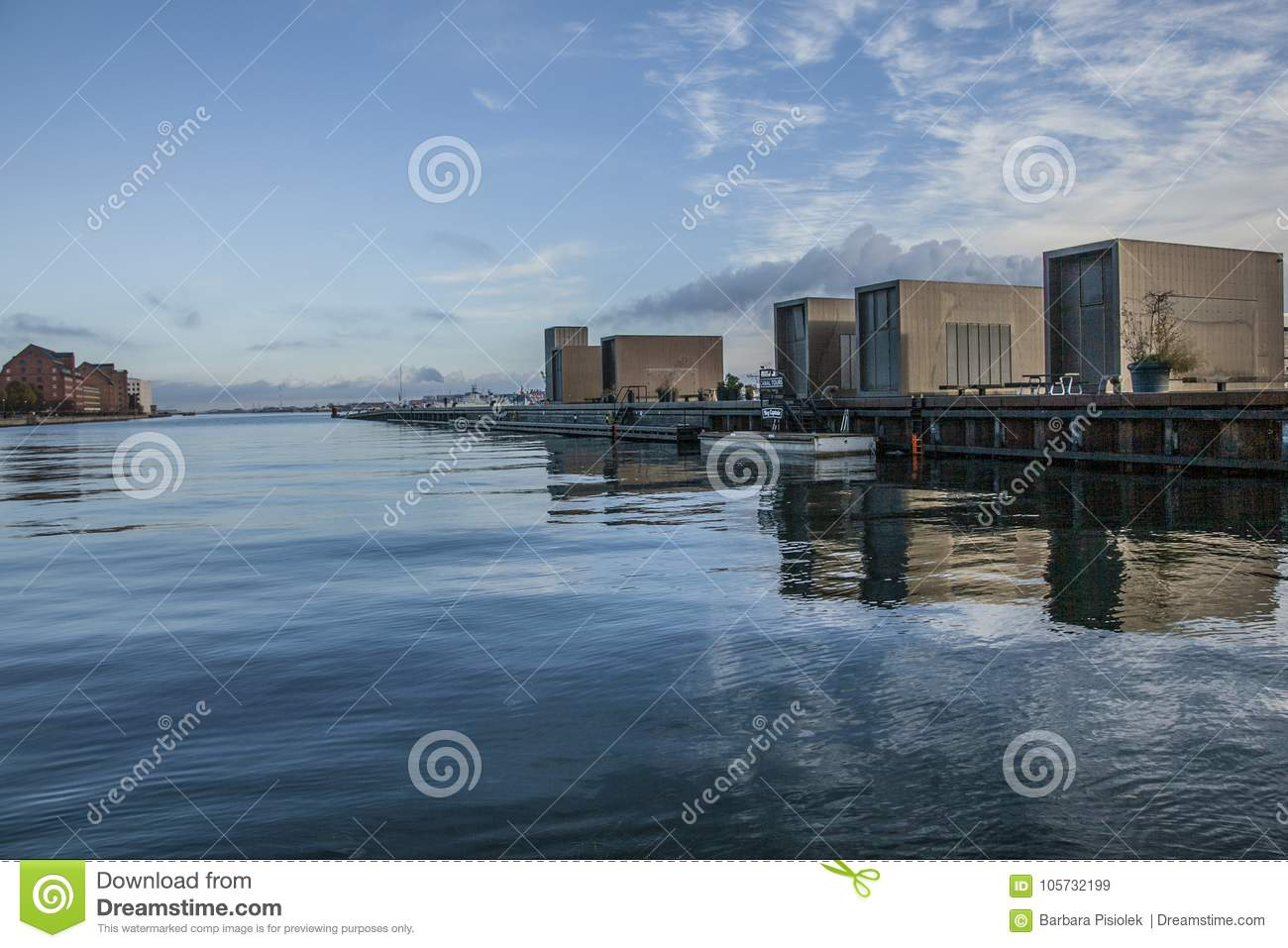 Copenhagen, Denmark - blue skies and seas and reflections of some buildings.