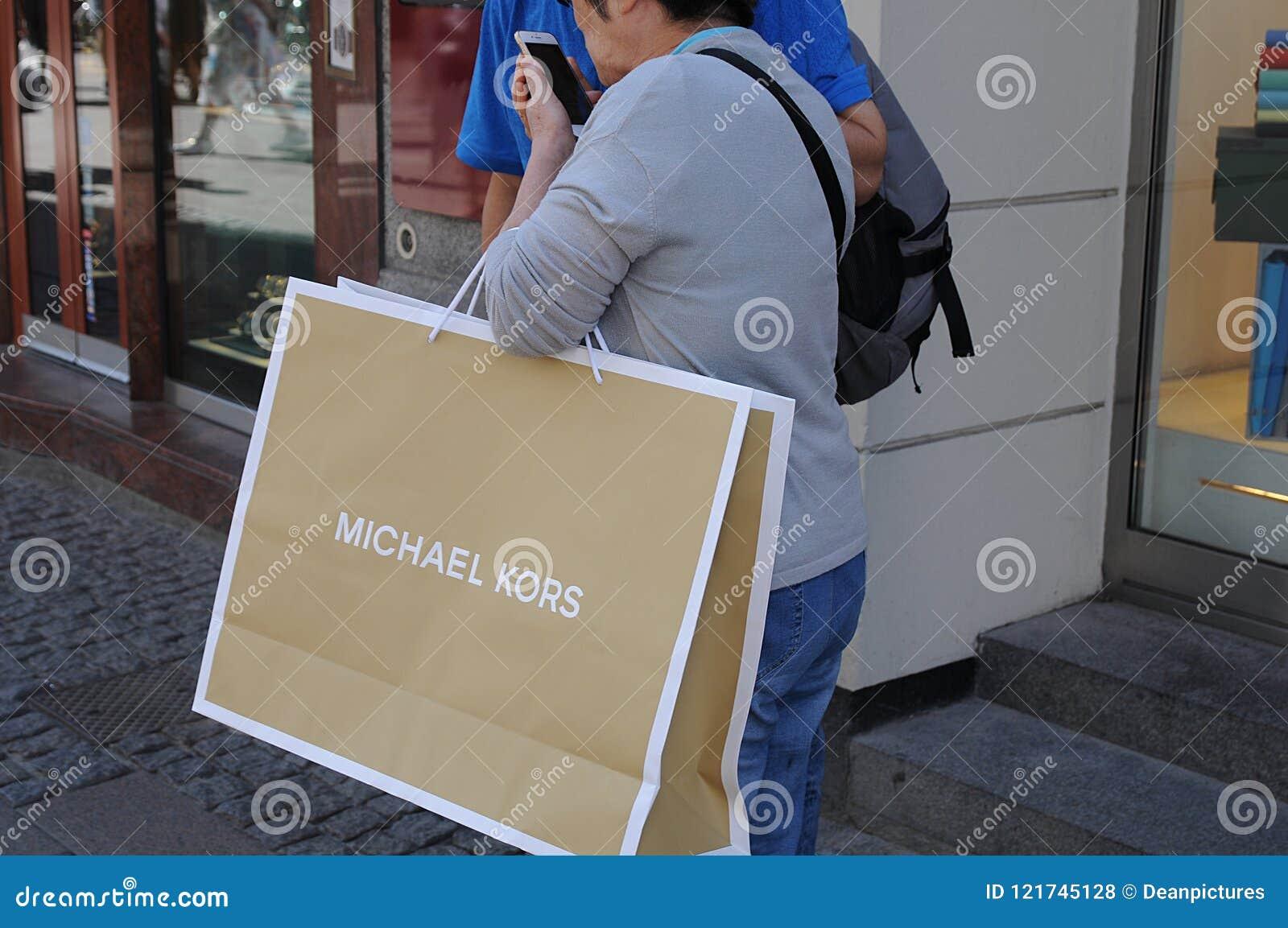 90dc70a589eeee Copenhagen/Denmark 20.JULY 2018_Michael kors hopperw with shopping bag .  Photo.Francis Joseph Dean / Deanpictures.