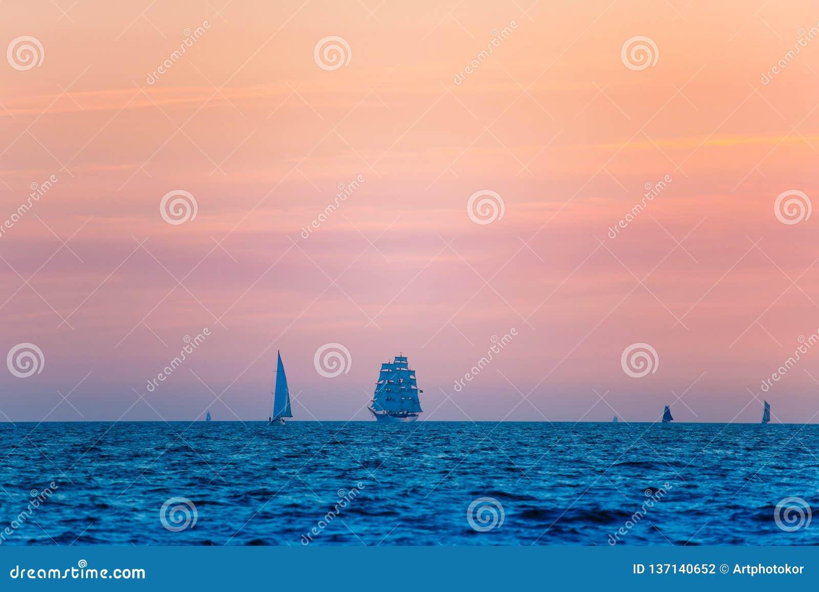 Sailing ships compete in regatta. Baltic sea