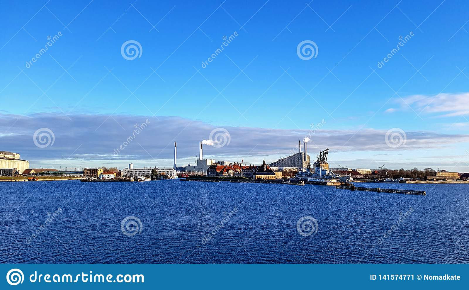 Copenhagen Industrial area district along sea with clear blue sky during sunset time