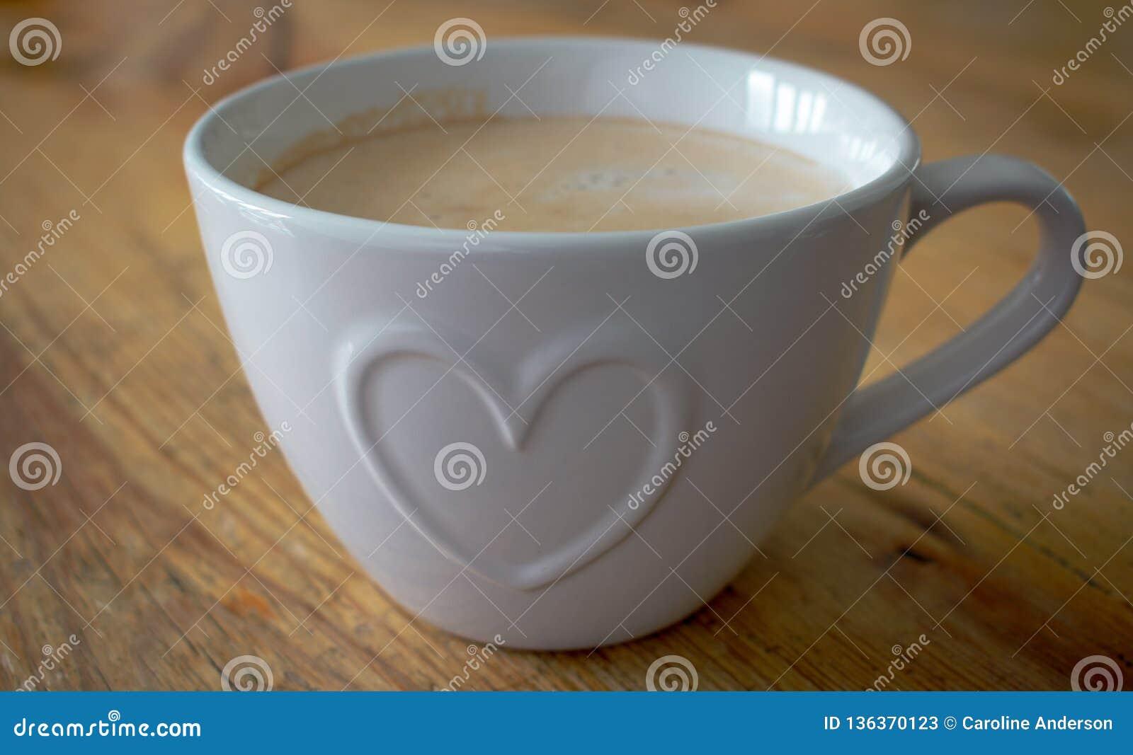 Copo de café com forma do coração
