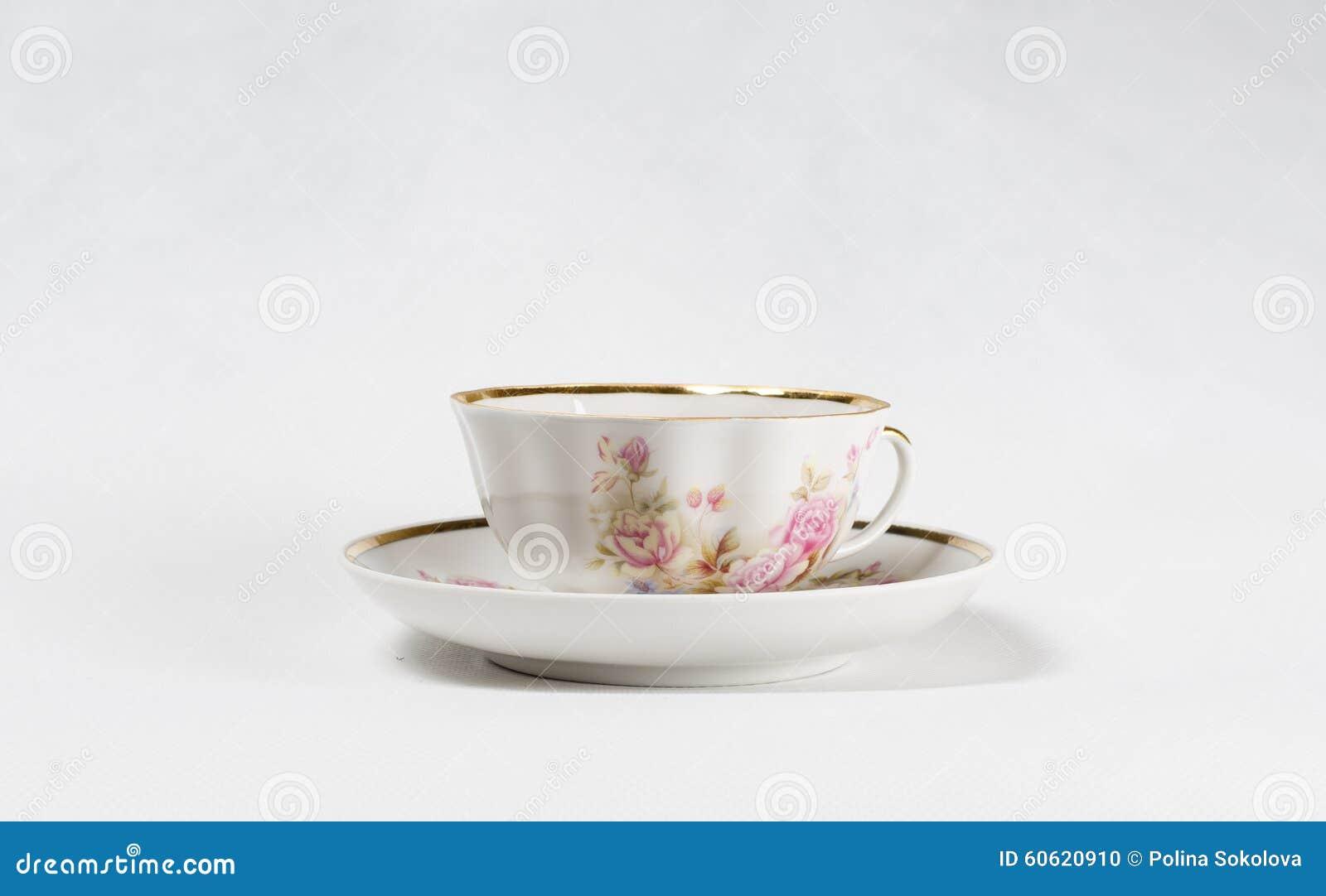 Copo de chá antigo da porcelana com pintura floral