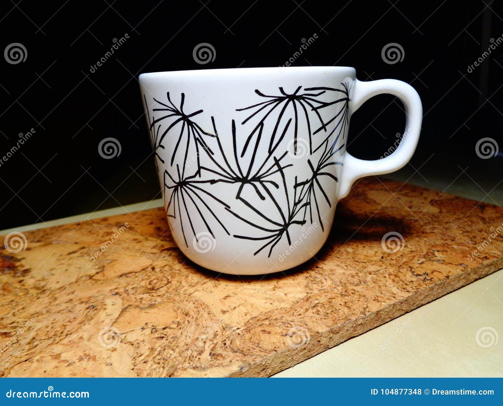 Copo de chá na tabela