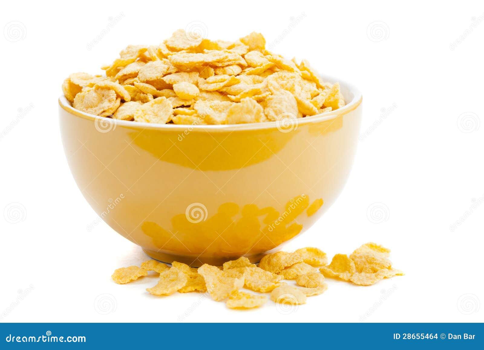 Copos de maíz del cereal en un cuenco