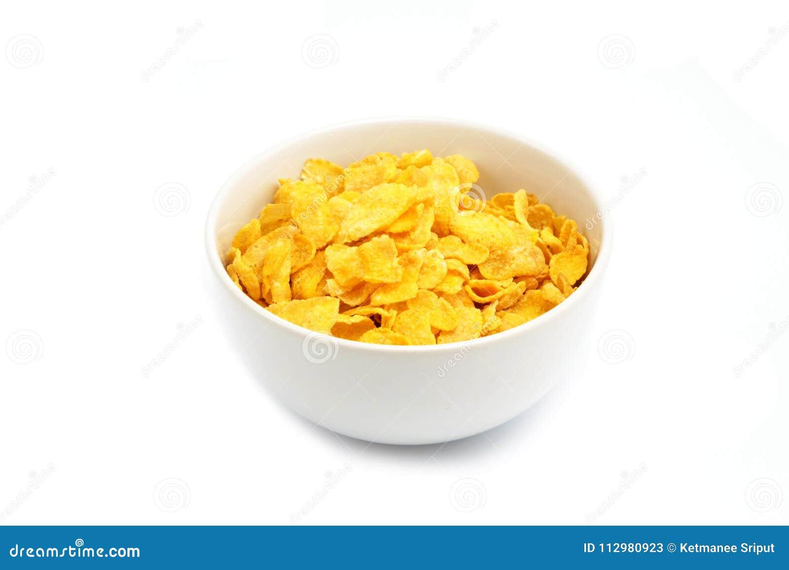 Copos de maíz o cereal en el fondo blanco