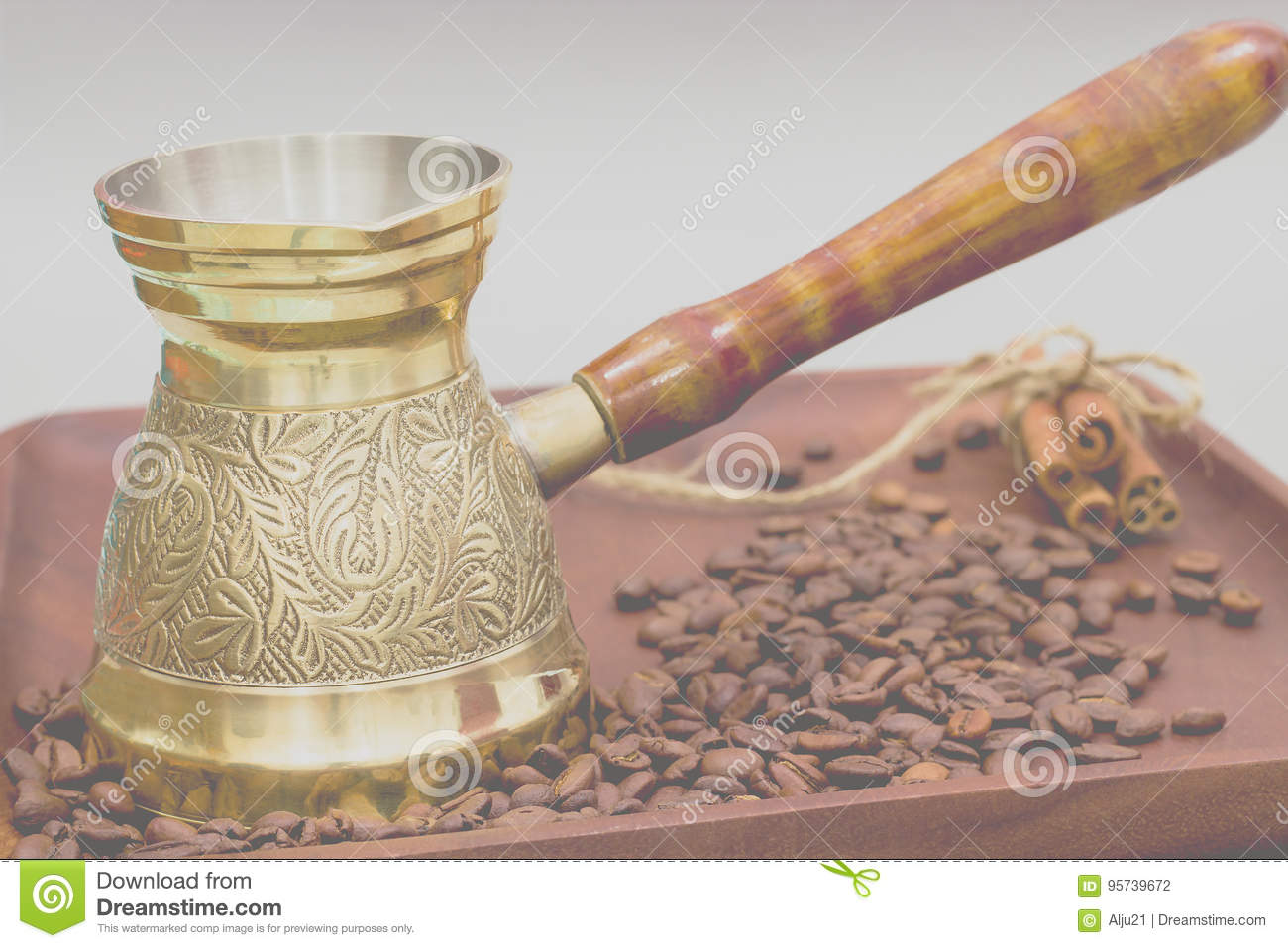 Copper coffee pot or ibrik with coffee beans and cinnamon sticks