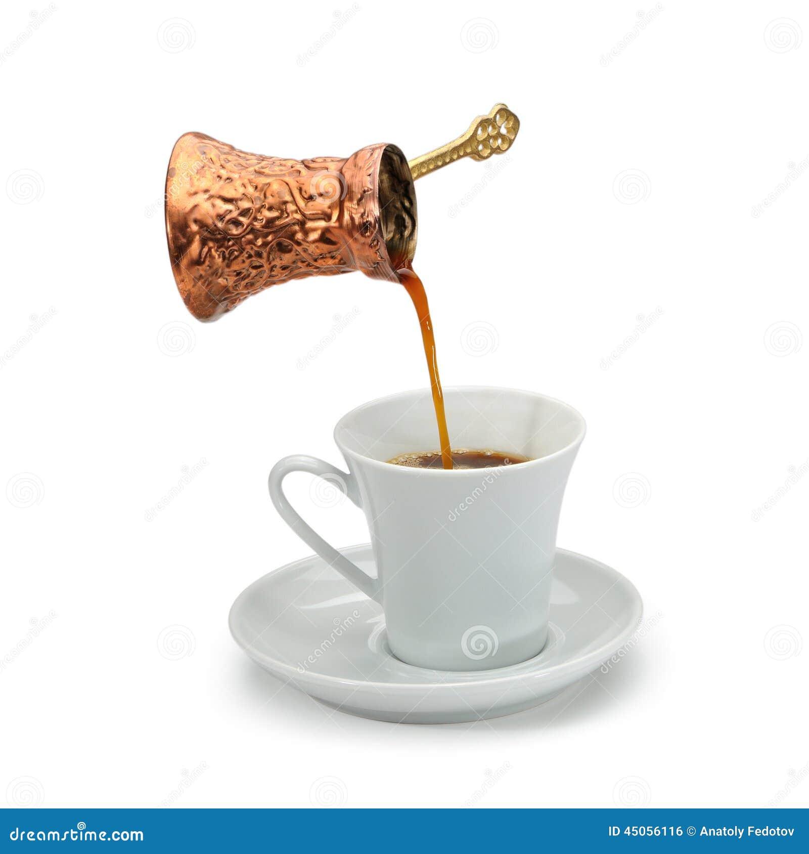 Copper Coffee Pot Pouring Coffee In A White Ceramic Coffee