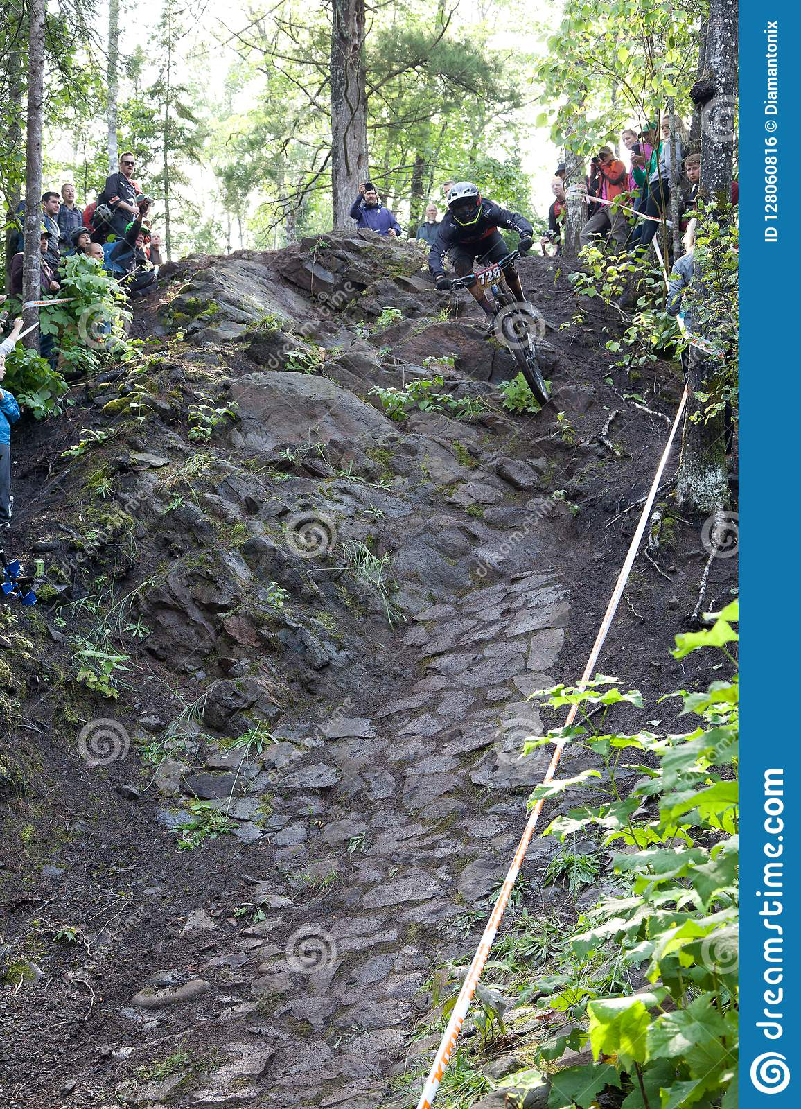 On 9/2/2017 in Copper Harbor, Michigan mountain biker launching from the cliff during enduro race