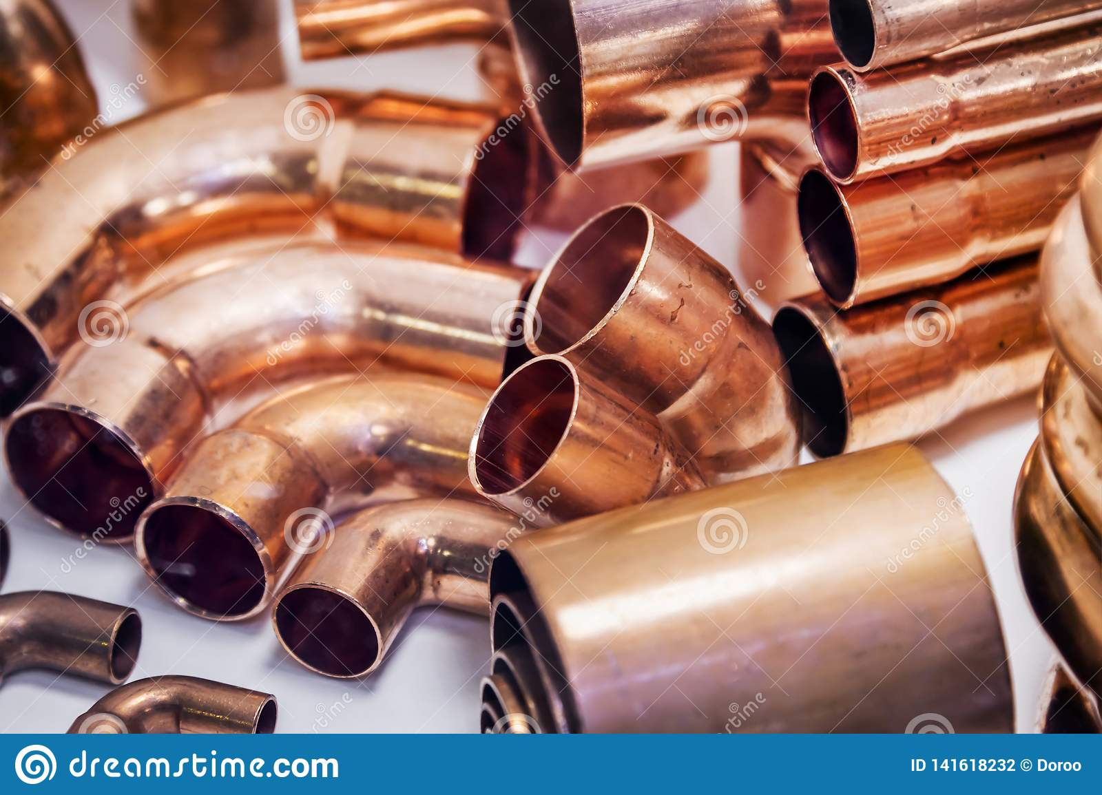 Copper Pipes Of Different Diameter And Sizes And Adapters